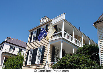 White Second Story Porch with Flags - A classic two story...