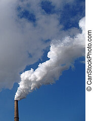 Smokes of a chimney on blue sky - Smokes of a chimney from a...
