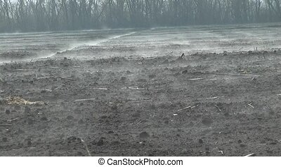 steam rises above the plowed field