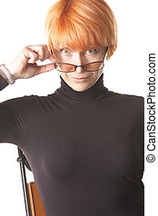 Surprized look over eyeglasses - Pretty redhead woman...