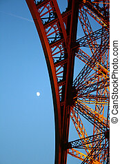 Eiffel tower detail with the moon in the sky
