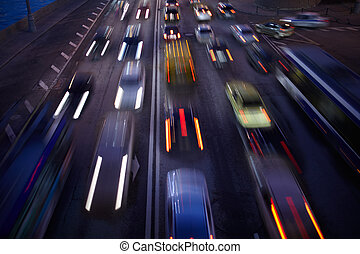 Car traffic at night. Motion blurred background. Long...