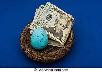 Nest Egg - Stack of twenty dollar bills sitting in nest with...