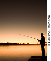 Fishing Silhoutte - The silhoutte of a man fishing in the...