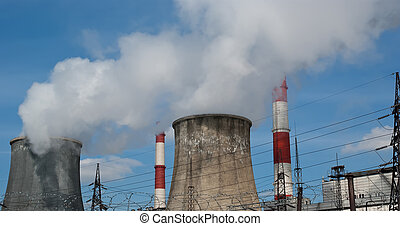 electric pylon and  pipes of coal  burning power station