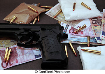drug money 15 - a stash of drugs gun and money showing a...