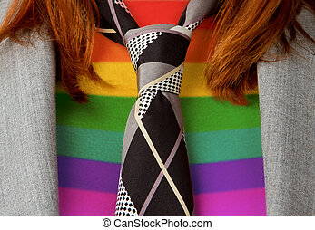 Caucasian business woman with a tie, rainbow flag pattern -...