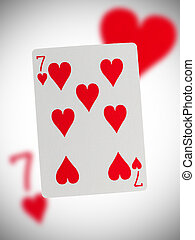 Playing card, seven of hearts - Playing card with a blurry...