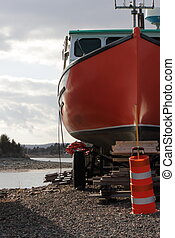 Lobster Boat - A lobster fishing boat sits on shore waiting...