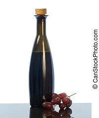 Balsamic vinegar bottle and grapes