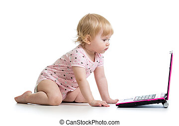 baby girl playing with laptop toy