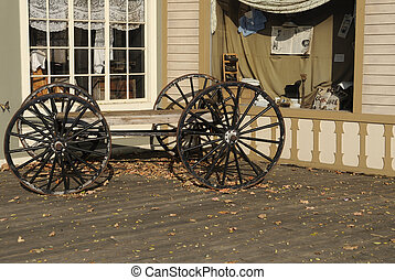 Buckboard wagon in front of country store