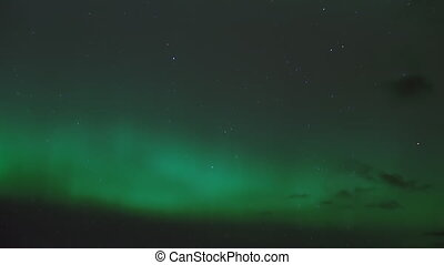 Northern Lights Aurora Clouds Stars - Sky shot time lapse of...