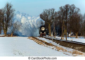 Old retro steam train - Vintage steam train puffing through...