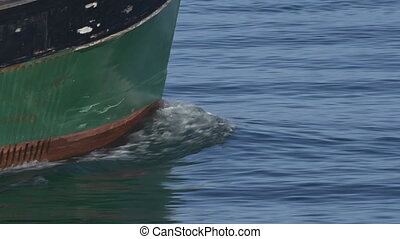 Fishing Boat Heading Out Tilt Bow - The bow of a time-worn...