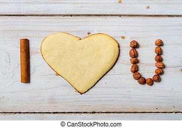 quot;I love youquot; sentence arranged with cookies and nuts...
