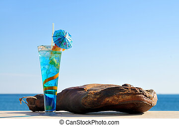 Cocktail with food on the beach