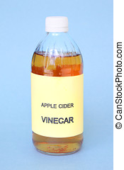 vinegar bottle - bottle of apple cider vinegar on blue...