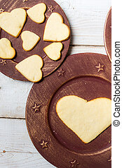 Heart-shaped cookies arranged on a plate no 4