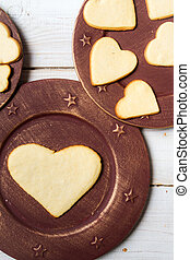 Heart-shaped cookies arranged on a plate no 5