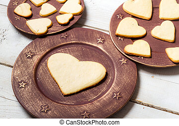 Heart-shaped cookies arranged on a plate no 6