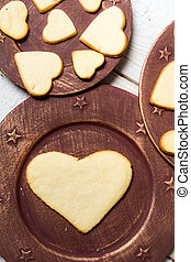 Heart-shaped cookies arranged on a plate no 7