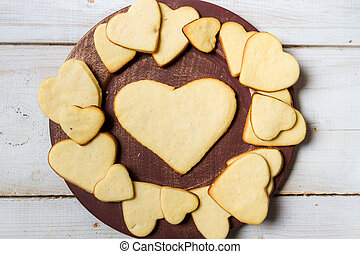 Heart-shaped cookies arranged on a plate no. 8