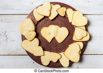 Heart-shaped cookies arranged on a plate no 10