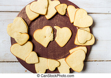 Heart-shaped cookies arranged on a plate no 11