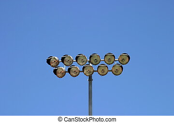 Floodlight from a football stadium with the sky as a...