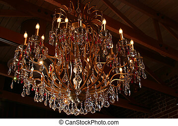 Chandelier - crystal light fixture under a wooden roof