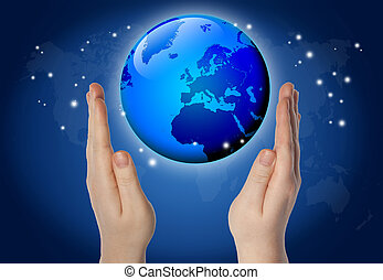 World in hands - world or globe in your hands on blue...