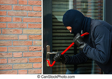 Thief with a crowbar - Burglar carrying the tool of choice