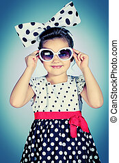 sunglasses retro - Portrait of a cute little pin-up girl in...