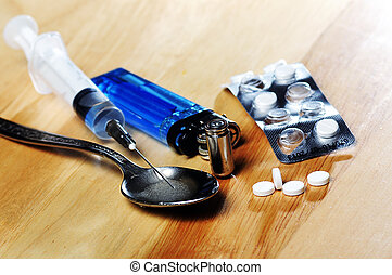 drugs addiction - syringe, spoon ,pills,bullet and lighter...