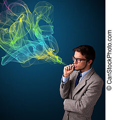 Handsome man smoking cigarette with colorful smoke