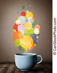 Tea cup with colorful speech bubbles, close up