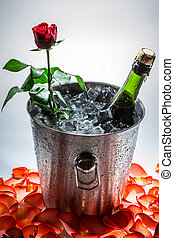 Red rose and cold champagne for Valentine's Day