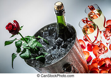 Red rose and cold champagne for celebration
