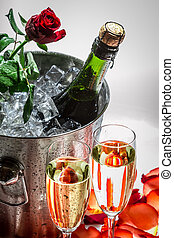 Closeu of red rose and cold champagne for Valentine's Day