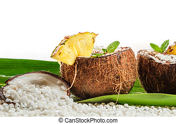 Pinacolada drink with fresh mint in coconut