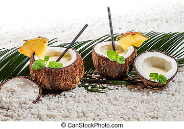 Pinacolada drink in coconut on beach