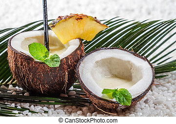 Pinacolada drink in the fresh coconut