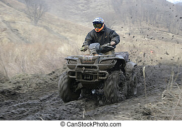 atv racing on dirt track at spring
