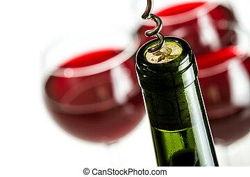 Opening green wine bottle