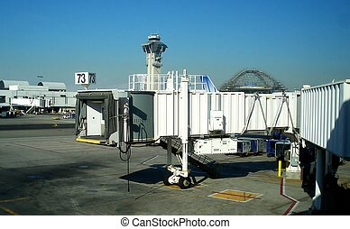 Jetway Seventy-Three - Jetway at an airport with control...