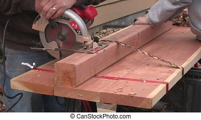 Man sawing wood close up