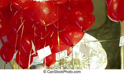 Heart shaped balloons - Lots of heart shaped balloons flying...