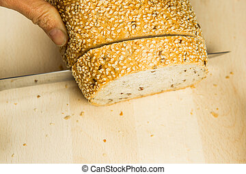 Sesame Seed Bread - Cutting sesame seed bread