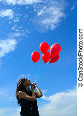 woman with red balloons
